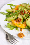 Salad with mango, avocado and walnuts Royalty Free Stock Images