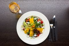 Salad with mango and goat cheese Royalty Free Stock Photography