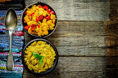 Salad of mango and tomato with red lentils with curry and dates Stock Photography