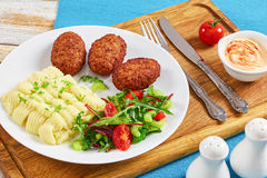 Salad, mashed potato and juicy meat cutlets Royalty Free Stock Images