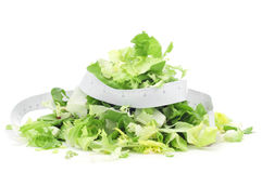Salad and measuring tape Stock Photos