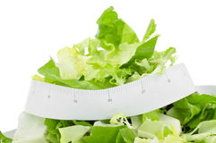 Salad and measuring tape Stock Images