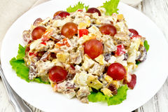 Salad of meat and cheese with grapes Stock Images