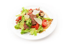 Salad from meat, cheese, tomato, mushrooms and salad leafs on white background Royalty Free Stock Images