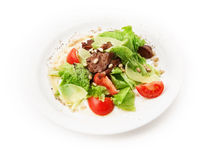 Salad from meat, cheese, tomato, pinienkernen and salad leafs on white background Royalty Free Stock Photos