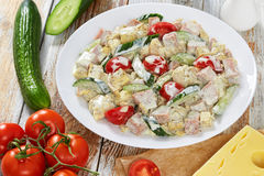 Salad with meat, cucumber, tomato, cheese, omelette Stock Images