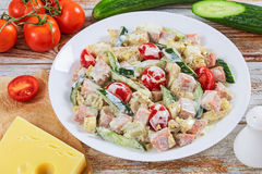 Salad with meat, cucumber, tomato, cheese, omelette Stock Image