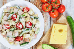 Salad with meat, cucumber, tomato, cheese, omelette Royalty Free Stock Images