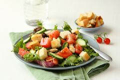 Salad with meat, cucumbers, tomatoes and croutons Stock Photos