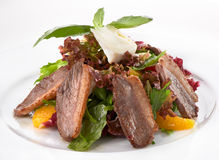 Salad with meat, lettuce and orange Royalty Free Stock Images