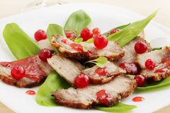 Salad with meat. Pork meat baked with sour cranberry sauce Royalty Free Stock Photo