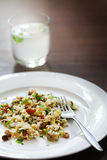 Salad with millet, avocado, cucumber, raisins and herbs, lemonade Stock Images