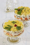 Salad Mimosa served in glass bowls and christmas tree ball Stock Images