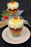 Salad  Mimosa in Verrine. Traditional Russian vegetable salad with fish. Salad Mimosa served in verrine Stock Photo