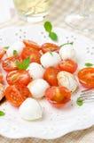 Salad with mini mozzarella, cherry tomatoes and basil Stock Photos