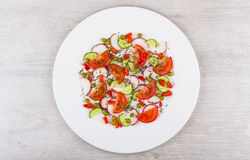 Salad from miscellaneous vegetables in white glass plate on tabl Stock Photography