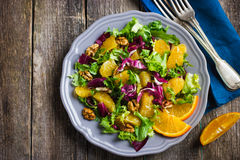 Salad mix with orange and walnuts Royalty Free Stock Photo