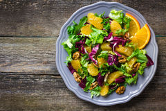 Salad mix with orange and walnuts Royalty Free Stock Photos
