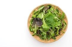Salad mix with rucola, frisee, radicchio and lamb's lettuce. On white background Stock Photo