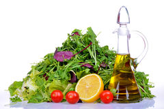 Salad mix with rucola, frisee, radicchio, lettuce and bottle of olive oil, lemon Royalty Free Stock Photo