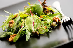 Salad mix with rucola, frisee, radicchio, lettuce and nuts  Stock Photo