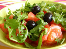 Salad mixed. Fresh green salad with tomato and olives Royalty Free Stock Photo