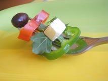 Salad mixed. Salad mixed on the fork Royalty Free Stock Image