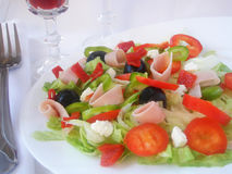 Salad mixed. Fresh green salad with red wino on the white background Stock Photo
