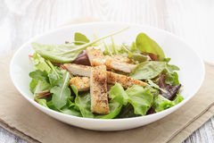 Salad from mixed herbs and fried chicken Stock Photography