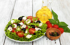 Salad with mozarella cheese and vegetables Stock Photo