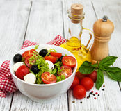 Salad with mozarella cheese and vegetables Stock Images