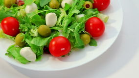 Salad with mozarella cheese, vegetables salad stock video footage