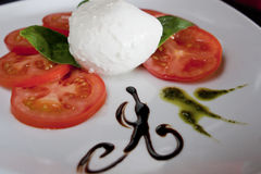 Salad mozarella and tomato. Salad with mozzarella cheese and fresh tomato Royalty Free Stock Images