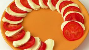 Salad  with mozzarella cheese and sliced tomatoes stock footage