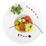 Salad with mozzarella and cherry tomatoes. Isolated on white background. Clipping path Royalty Free Stock Image