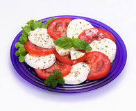 Salad, mozzarella, tomato and basil Royalty Free Stock Photography