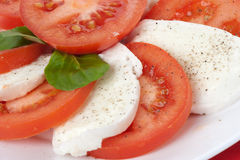 Salad with mozzarella and tomatoes Stock Photo