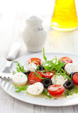 Salad with mozzarella, tomatoes and black olive Royalty Free Stock Photo