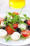Salad with mozzarella, tomatoes and black olive Stock Photos