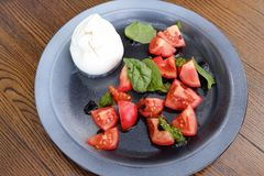 Salad with mozzarella and tomatoes delicious dinner Royalty Free Stock Photo