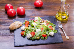Salad with mozzarella and tomatoes Stock Photo