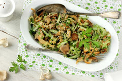 Salad with mushrooms and cucumber Stock Image