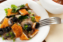 Salad with mushrooms, olives and chicken breast Stock Image
