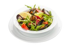 Salad with mussels and chorizo. A traditional Spanish dish. On a white background royalty free stock photography