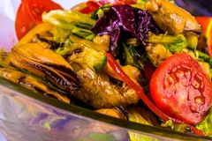 Salad with mussels and vegetables in bowl Stock Photo