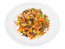 Salad with mussels and vegetables on plate, white background Royalty Free Stock Images