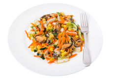 Salad with mussels and vegetables on plate, white background Royalty Free Stock Photos