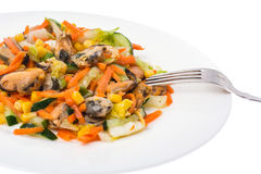 Salad with mussels and vegetables on plate, white background Stock Photo