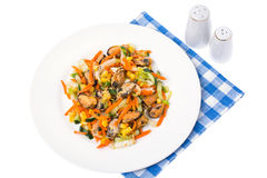 Salad with mussels and vegetables on plate, white background Stock Image