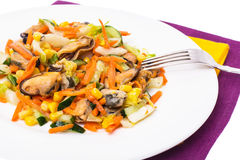 Salad with mussels and vegetables on plate, white background Royalty Free Stock Image
